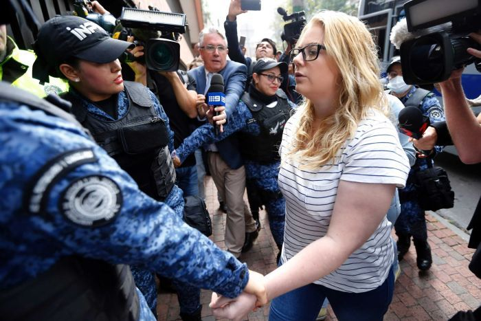 "Australian Cassandra ""Cassie"" Sainsbury, 22, is escorted by police to a court hearing in Bogota."