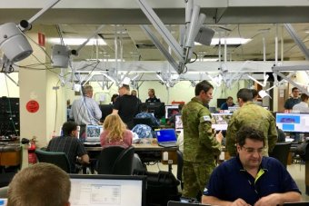Defence and equipment personnel at an exercise command centre.