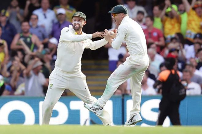 Australia's Nathan Lyon (L) and David Warner celebrate the end of England's James Vince at Gabba.