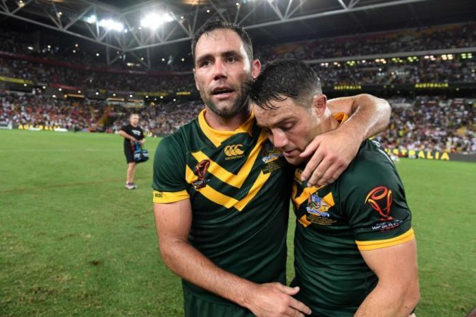 Cameron Smith embraces Cooper Cronk after Rugby League World Cup final.
