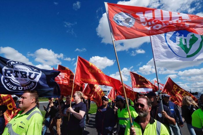 Union members march to Webb Dock during an industrial action dispute in Melbourne, Friday, December 8, 2017.