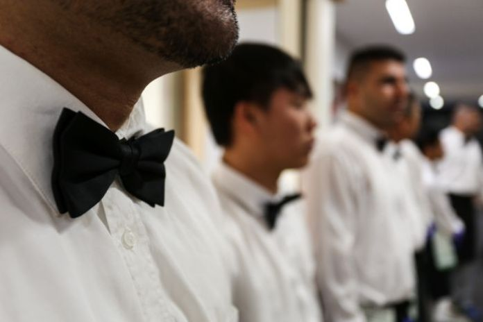 A close up of a row of black ties worn by the prisoners.