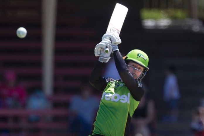 Rachael Haynes watches the ball after playing to the leg side against the Renegades in their WBBL match at North Sydney Oval.