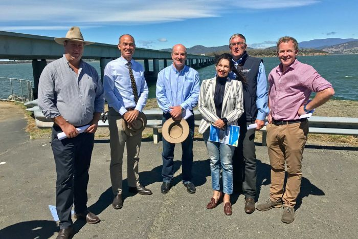 Tasmanian Premier Will Hodgman (r) with the candidates for Lyons.