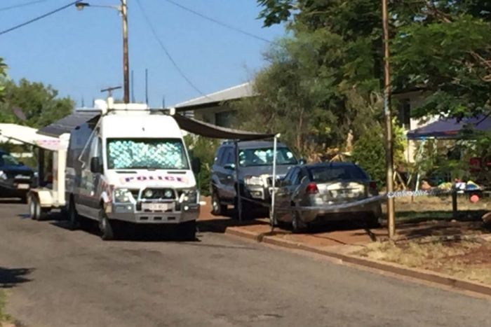 Police vehicles outside a house in Mount Isa in north-west Queensland.