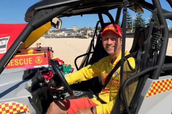 Lifesaver Doron Milner sits in the surf lifesaving buggy at Bondi.