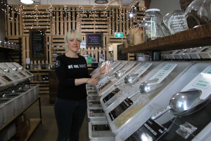 Naked Foods staff member Sophie Dumaresq stand inside the health store