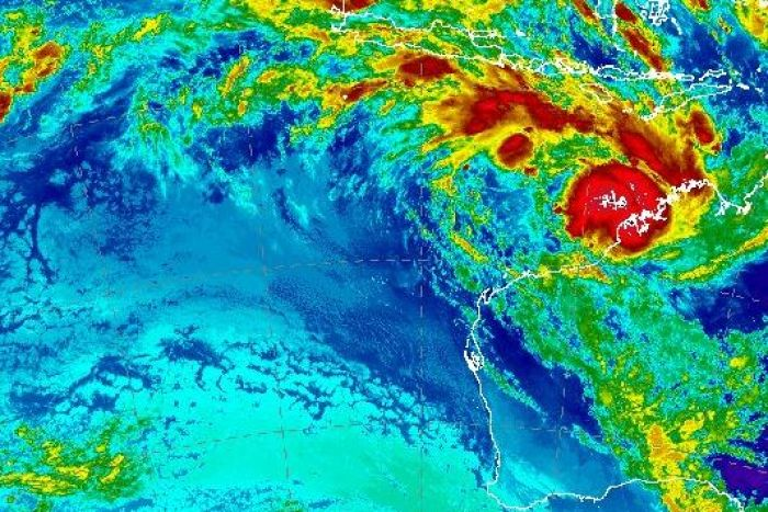 A satellite image showing a tropical low off the WA coast. The area of highest intensity sits just on the coast.
