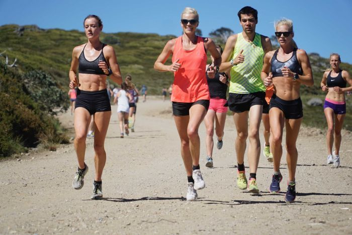 Eloise Wellings joins a group of athletes running on trails at Falls Creek in Victoria.