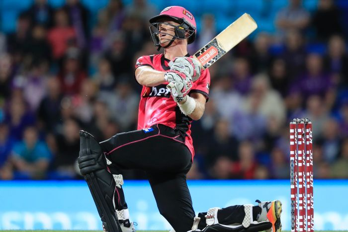 Sam Billings hits out while on one knee for the Sixers in their BBL clash with the Hurricanes in Hobart.