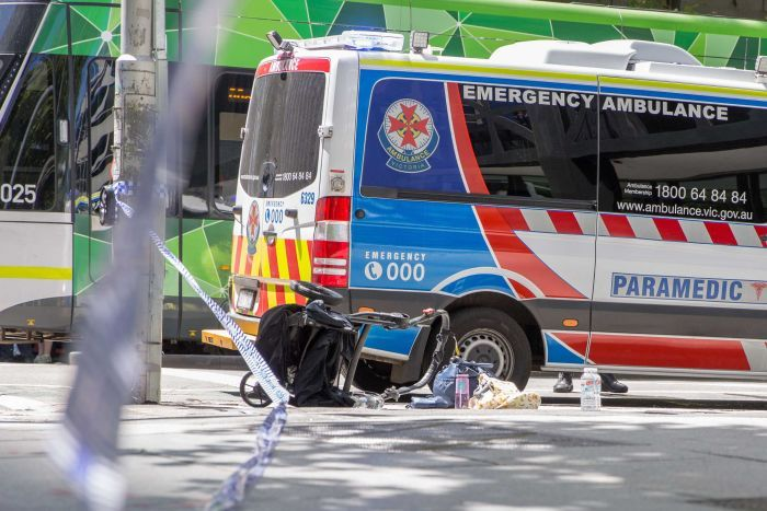 A pram is tipped over at the scene of the Bourke Street attack.