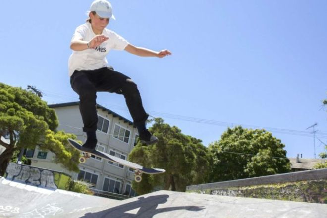 Young skateboarder and Olympic hopeful Liv Lovelace does a trick.