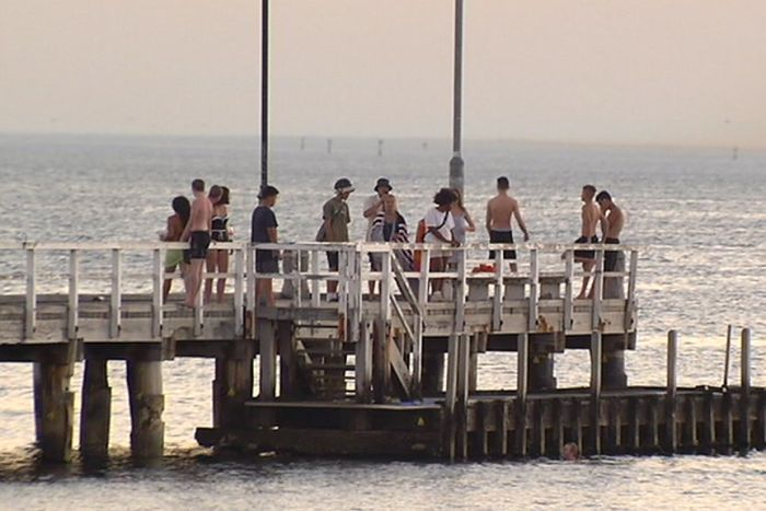 People gather at the pier at South Melbourne.