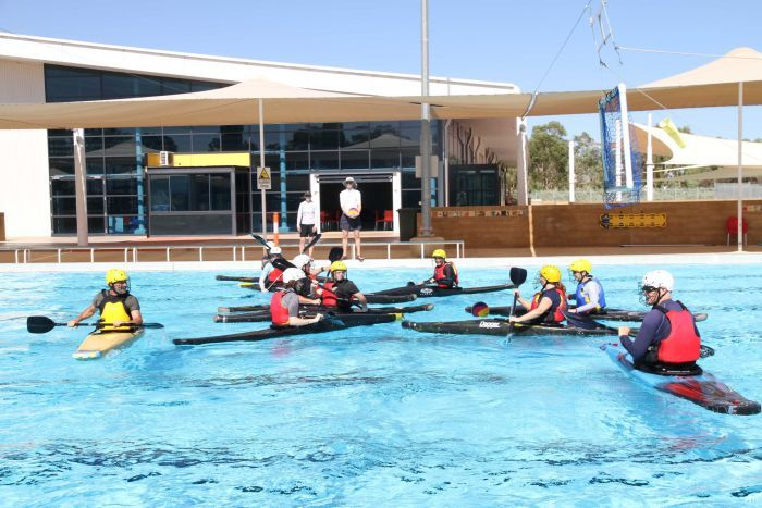 Canoe polo players go head-to-head in the Alice Springs pool.