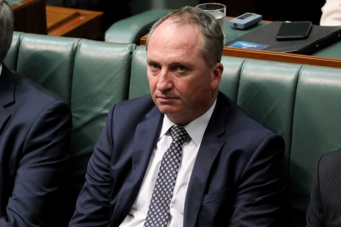 Barnaby Joyce sits in the House of Representatives with a tired expression on his face. He frowns, with bags beneath his eyes.
