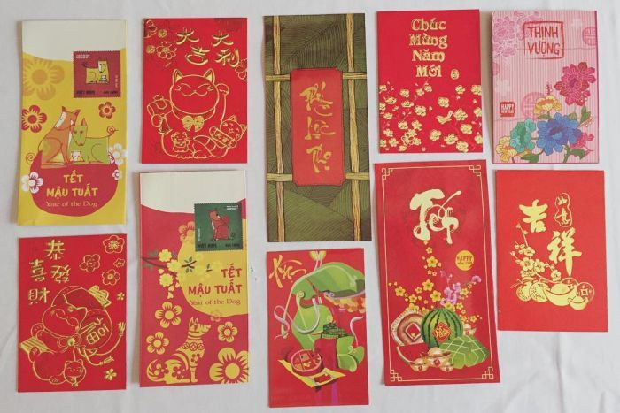 Ten different red packets with various Year of the Dog designs.