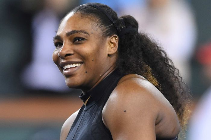 Serena Williams smiles as she looks to the crowd after winning her comeback match in Indian Wells.