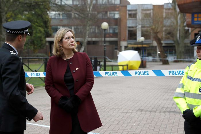 Amber Rudd stands in front of a police tape blocking off the scene where Sergei Skripal was found after being poisoned