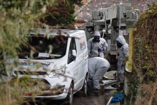 Military forces examine a van in Winterslow