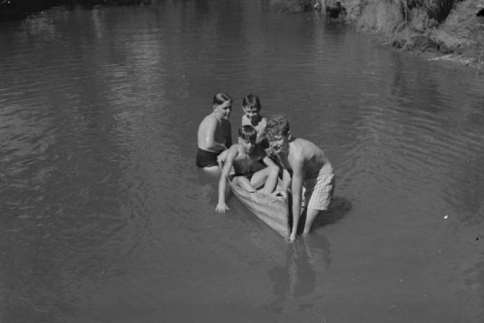 Boys in a canoe made of tin at Fairbridge 1950