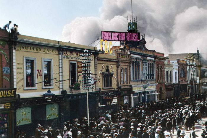 A colourised historical photograph of smoke rising from the John Martin's department store in Adelaide, 1901.