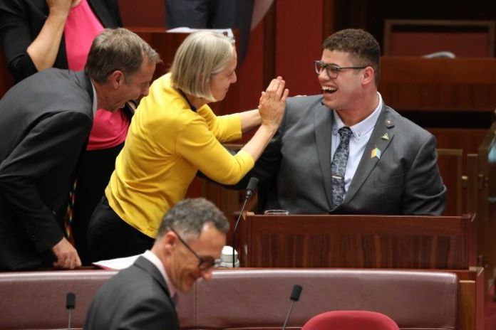 Senators praise their colleague after he delivered his maiden speech in the Parliament