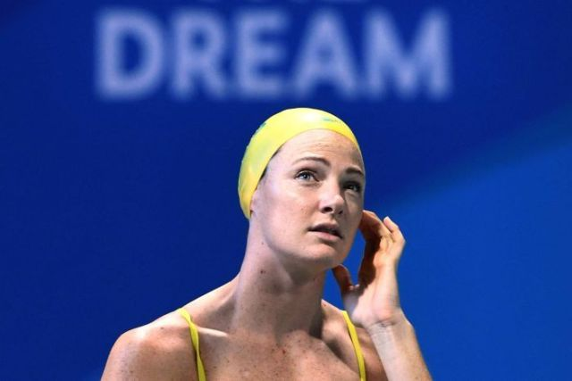 Cate Campbell looks up into the stands at an Australian training session on the Gold Coast.