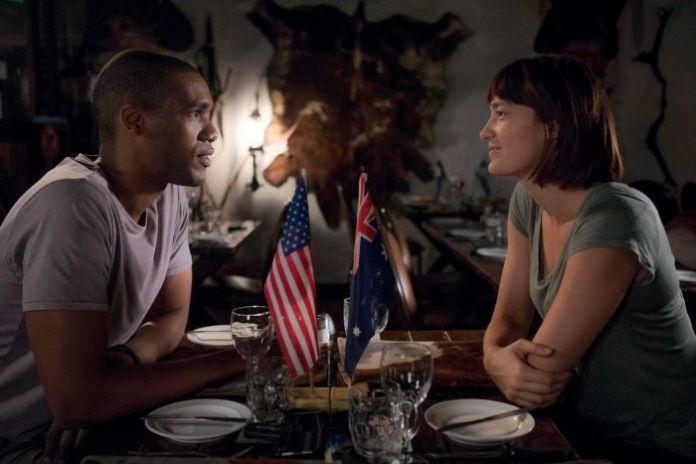Actors in Netflix series Pine Gap smiling at each other.