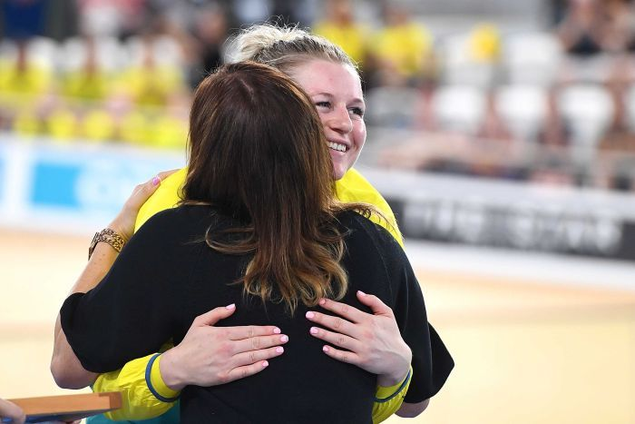 Stephanie Morton hugs former cyclist Anna Meares after winning gold in the Women's Sprint Finals.