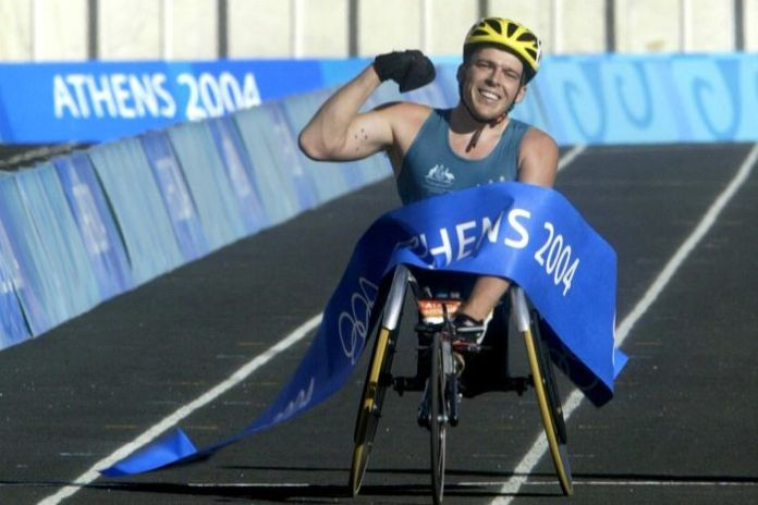 Australian Kurt Fearnley crosses finish line to win men's T54 marathon at the Athens Paralympics.