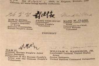 Photo of the English text of the Korean Armistice Agreement, with signatures at the bottom.