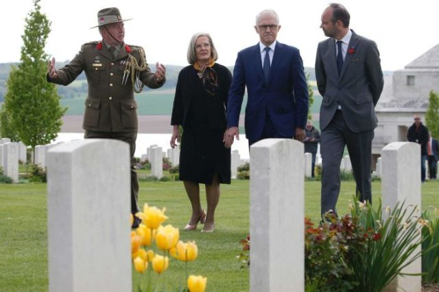 Australian Colonel Scott Clingan escorts Edouard Philippe, Malcolm Turnbull and Lucy Turnbull.