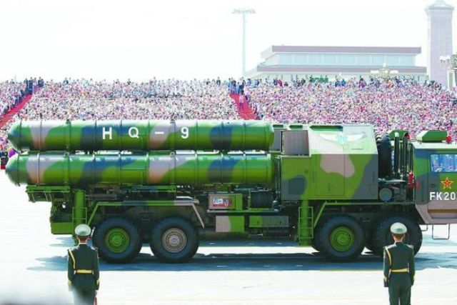 The green camouflaged missiles sit on a launch truck of the same colour.