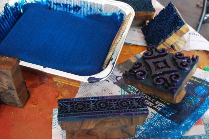 The intricate, wooden printing blocks dipped in blue paint