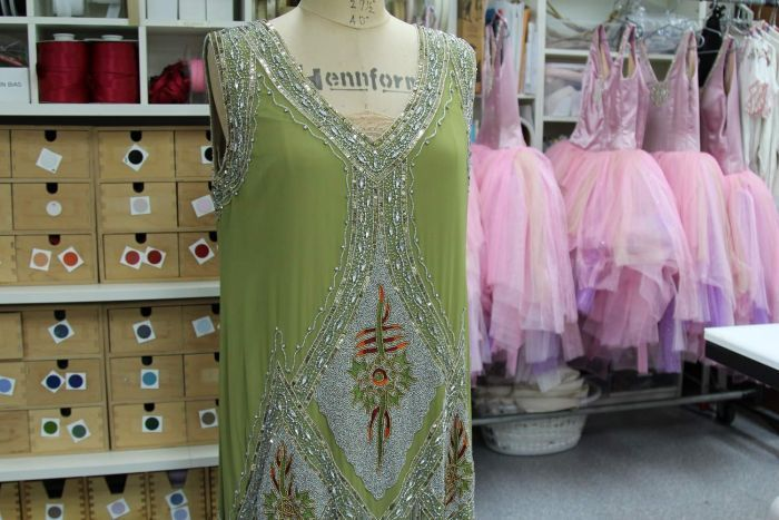 Flapper-style beaded dress with pink tutus in background