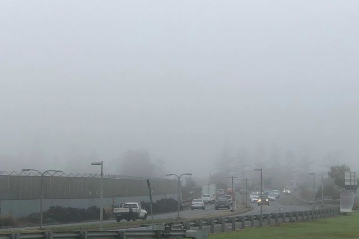 Heavy fog blankets above a busy Adelaide road on Monday, June 4, 2018.