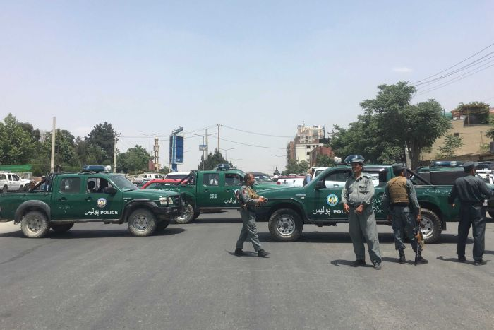 Security personnel block the road with their vehicles