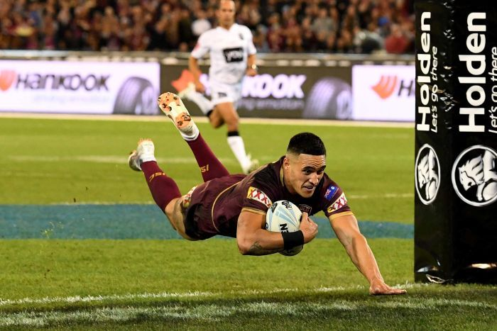 Valentine Holmes dives over to score