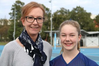 Olivia pictured with her mum after playing a game of netball.