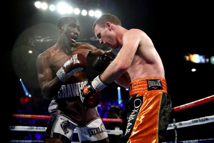 Terence Crawford punches Jeff Horn in their world welterweight boxing title bout in June 2018.