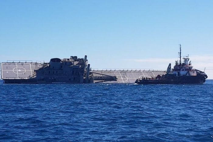 ex_HMAS Tobruk on its side in the ocean