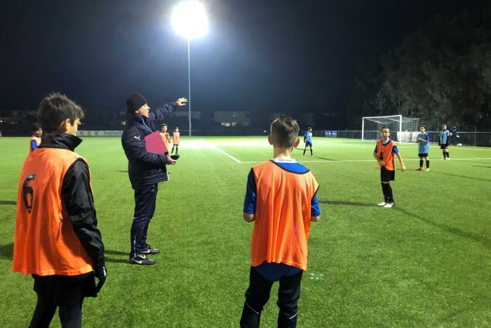 Sydney FC academy leader Kelly Cross puts some of his young charges through their paces.