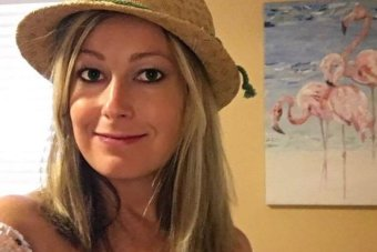 Rebecca Smith wearing a hat and dress.