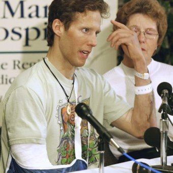 Climber Aron Ralston with his amputated arm bandaged