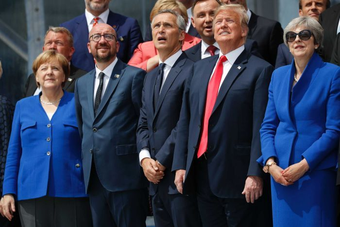 NATO leaders look up at a ceremonial fly-over