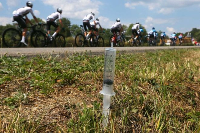 Team Sky passes one of several syringes put beside the road on Tour de France stage four, 2018.