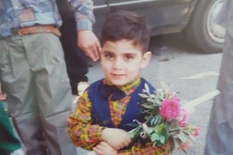 Fadi Chalouhy holding flowers as a child