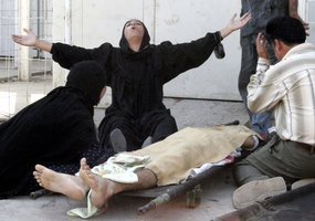 An  Iraqi woman grieves over the body of a man
