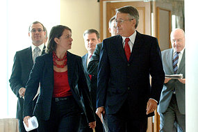 Federal Treasurer Wayne Swan and Federal Health Minister Nicola Roxon emerge from a meeting
