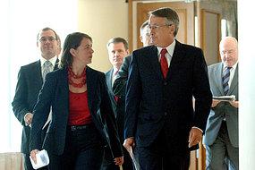 Federal Treasurer Wayne Swan and Federal Health Minister Nicola Roxon emerge from a meeting